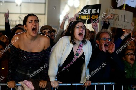 Protestors shout slogans on the fourth day of a demonstration outside Malta's prime minister's office in Valletta, Malta, . On Wednesday, Nov. 28, 2019 Maltese police arrested Prime Minister Joseph Muscat's former chief of staff Keith Schembri for questioning as a person of interest in the murder of journalist Daphne Caruana Galizia