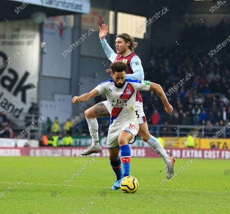 30th November 2019, Turf Moor, Burnley, England; Premier League, Burnley v Crystal Palace : Andros Townsend (10) of Crystal Palace rides a challenge from Jeff Hendrick (13) of BurnleyCredit: Conor Molloy/News Images