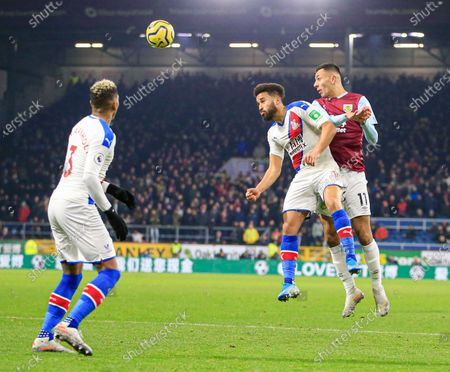 30th November 2019, Turf Moor, Burnley, England; Premier League, Burnley v Crystal Palace : Dwight McNeil (11) of Burnley wins the header against Andros Townsend (10) of Crystal PalaceCredit: Conor Molloy/News Images
