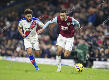 30th November 2019, Turf Moor, Burnley, England; Premier League, Burnley v Crystal Palace : Dwight McNeil (11) of Burnley races past Andros Townsend (10) of Crystal PalaceCredit: Conor Molloy/News Images