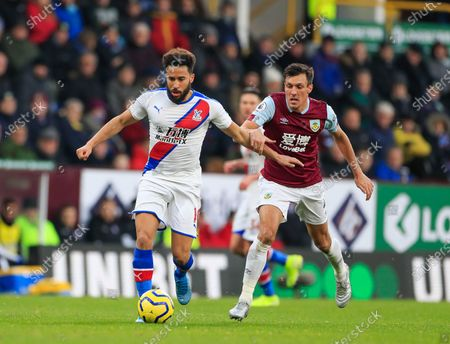 30th November 2019, Turf Moor, Burnley, England; Premier League, Burnley v Crystal Palace : Andros Townsend (10) of Crystal Palace is held back by Jack Cork (4) of BurnleyCredit: Conor Molloy/News Images