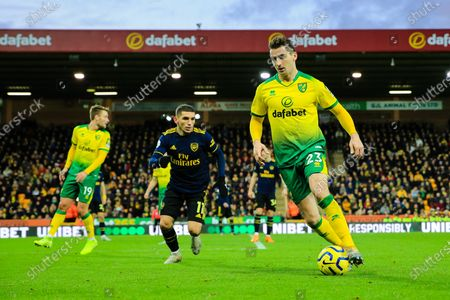 1st December 2019, Carrow Road, Norwich, England; Premier League, Norwich City v Arsenal : Kenny McLean (23) of Norwich City controls the ball ahead of Lucas Torreira (11) of Arsenal 
