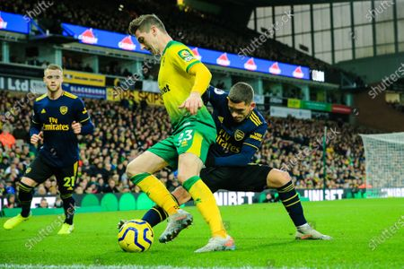 1st December 2019, Carrow Road, Norwich, England; Premier League, Norwich City v Arsenal : Kenny McLean (23) of Norwich City is tackled by Lucas Torreira (11) of Arsenal 