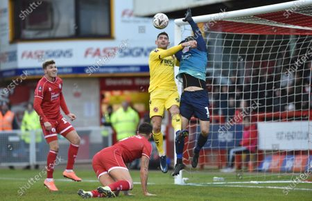 Ched Evans of Fleetwood challenges goalkeeper Glenn Morris of Crawley which led to their second goal scored by Patrick Madden during the Emirates FA Cup 2nd Round match between Crawley Town and Fleetwood Town at the People's Pension Stadium Crawley , UK - 01 December 2019