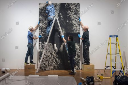 "Technicians install ""Verkreuzung"", 1972, by Valie Export. Preview of ""The 1980 Venice Biennale Works"" by the Austrian artist Valie Export at Galerie Thaddeus Ropac in Mayfair. The exhibition comprises innovative multimedia installation from the 39th Venice Biennale and 17 large-scale photographs mounted on wooden panels from her important photographic series Body Configurations (1972-82). The show runs 28 November to 25 January 2020."
