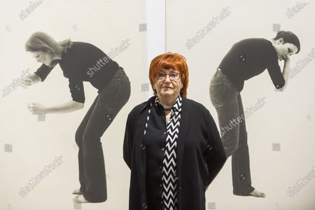 "Austrian artist Valie Export poses with her works ""Petri/fikation"", 1976, at the preview of her exhibition ""The 1980 Venice Biennale Works"" at Galerie Thaddeus Ropac in Mayfair. The exhibition comprises innovative multimedia installation from the 39th Venice Biennale and 17 large-scale photographs mounted on wooden panels from her important photographic series Body Configurations (1972-82). The show runs 28 November to 25 January 2020."