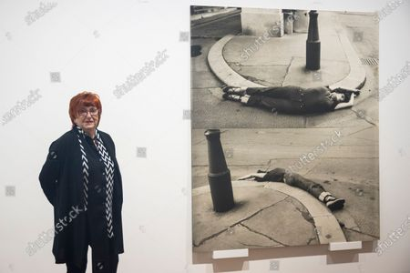 """Austrian artist Valie Export poses with works from her """"Arbrundung"""", 1976, series at the preview of her exhibition """"The 1980 Venice Biennale Works"""" at Galerie Thaddeus Ropac in Mayfair. The exhibition comprises innovative multimedia installation from the 39th Venice Biennale and 17 large-scale photographs mounted on wooden panels from her important photographic series Body Configurations (1972-82). The show runs 28 November to 25 January 2020."""