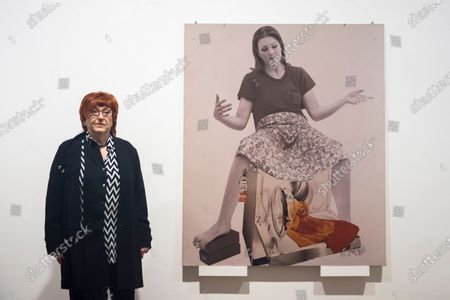 "Austrian artist Valie Export poses with ""Die Geburtenmadonna"", 1976, at the preview of her exhibition ""The 1980 Venice Biennale Works"" at Galerie Thaddeus Ropac in Mayfair. The exhibition comprises innovative multimedia installation from the 39th Venice Biennale and 17 large-scale photographs mounted on wooden panels from her important photographic series Body Configurations (1972-82). The show runs 28 November to 25 January 2020."