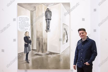 "Polish artist Marcin Maciejowski poses with his work ""It Certainly Has A Fairly Intriguing - Strange Composition"", 2019. First look of ""Private View"" by Marcin Maciejowski at Galerie Thaddeus Ropac in Mayfair. The artist's first London exhibition features new large-scale paintings and graphic works on paper merging comic-book and Old Master traditions. The show runs 28 November to 25 January 2020."