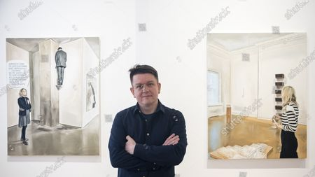 "Polish artist Marcin Maciejowski poses with his works (L) ""It Certainly Has A Fairly Intriguing - Strange Composition"" and (R) ""It Is Enough I'm Delighted, Don't Make Me Understand It"", both 2019. First look of ""Private View"" by Marcin Maciejowski at Galerie Thaddeus Ropac in Mayfair. The artist's first London exhibition features new large-scale paintings and graphic works on paper merging comic-book and Old Master traditions. The show runs 28 November to 25 January 2020."