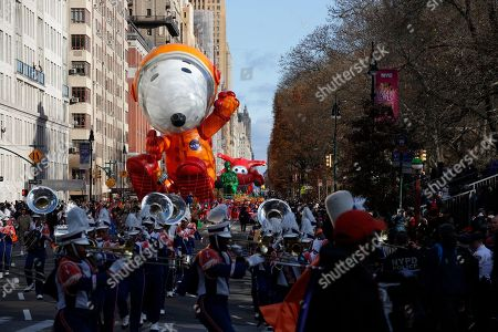 Astronaut Snoopy balloon makes its way down New York's Central Park West during the Macy's Thanksgiving Day Parade, in New York
