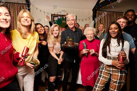 With an extraordinary 19.5 million Christmas Puddings consumed nationwide Phillip Schofield (centre) joins sweet toothed taste testers from the Henley WI and a group of young local people in testing this years puds