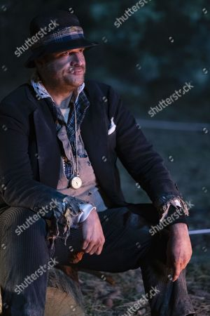 Stock Photo of Macon Blair as George
