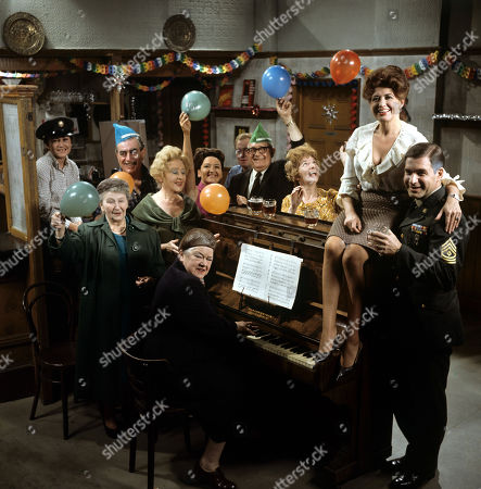 Violet Carson (as Ena Sharples) on piano with from the right Pat Phoenix (as Elsie Tanner), Paul Maxwell (as Steve Tanner), Jean Alexander (as Hilda Ogden), Arthue Leslie (as Jack Walker), Graham Haberfield (as Jerry Booth), Eileen Derbyshire (as Emily Nugent), Doris Speed (as Annie Walker), Bernard Youens (as Stan Ogden), Jennifer Moss (as Lucille Hewitt) and Margot Bryant (as Minnie Caldwell) Coronation Street Christmas - 1967