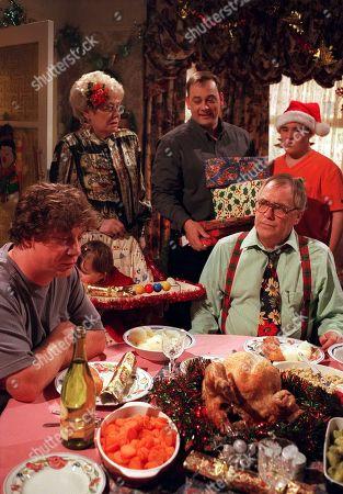Stock Photo of Liz Dawn, Nigel Pivaro and William Tarmey (as Vera, Terry and Jack Duckworth) with Alan Halsal (as Tyrone Dobbs) and Ian Mercer (as Gary Mallett), Coronation Street Christmas - 1999