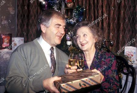 Stock Image of Peter Baldwin (as Derek Wilton) and Thelma Barlow (as Mavis Wilton), Coronation Street Christmas - 1992