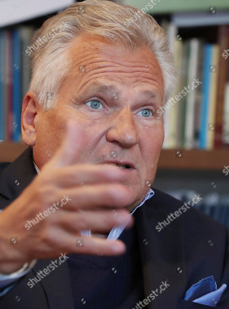 Aleksander Kwasniewski, a former Polish president and currently a board member for Ukrainian gas company Burisma, speaks to The Associated Press in his office in Warsaw, Poland, . Kwasniewski says that when Hunter Biden was tapped in 2014 to join its advisory board, he told then-Vice President Joe Biden's son that the company was working to overcome a difficult past and was determined to be well-managed and transparent. Kwasniewski also said he also told the younger Biden that if Burisma succeeded in tapping into Ukraine's gas deposits, it would help Ukraine gain energy independence from Russia, a key part of its broader struggle to exist as an sovereign nation