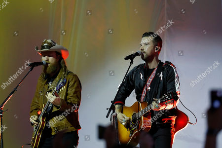 Stock Image of John Osborne, left, and T.J. Osborne of the Brothers Osborne musical duo perform during halftime of an NFL football game between the Detroit Lions and the Chicago Bears, in Detroit