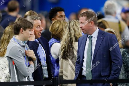 Stock Photo of Detroit Lions vice chair Bill Ford, left, talks with general manager Bob Quinn during pregame of an NFL football game between the Detroit Lions and the Chicago Bears, in Detroit