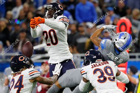 Chicago Bears cornerback Prince Amukamara (20), free safety Eddie Jackson (39), and cornerback Buster Skrine (24) help break up the pass intended for Detroit Lions wide receiver Marvin Jones (11) during the second half of an NFL football game, in Detroit