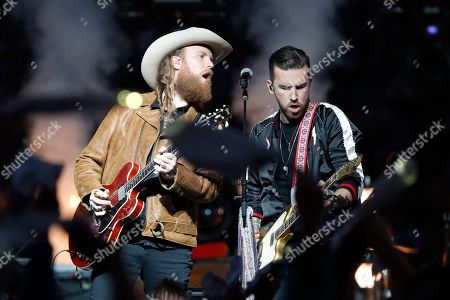 John Osborne, left, and T.J. Osborne of the Brothers Osborne musical duo perform during halftime of an NFL football game between the Detroit Lions and the Chicago Bears, in Detroit
