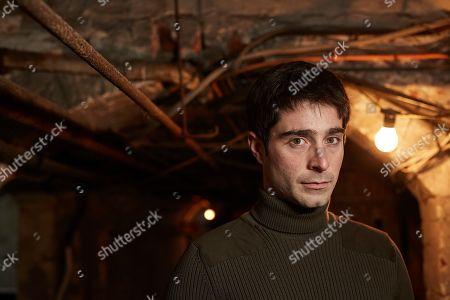 Stock Picture of Tom Wells as Adam Mullen.