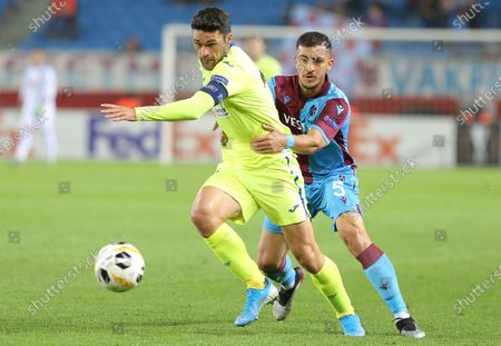 Trabzonspor's Majid Hosseini (R) in action against Getafe's Jorge Molina (L) during the UEFA Europa League group C soccer match between Trabzonspor and Getafe CF in Trabzon, Turkey 28 November 2019.