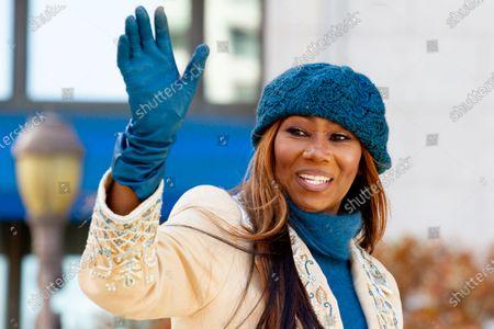 Gospel singer Yolanda Adams waves to spectators during the 6ABC Thanksgiving Day Parade
