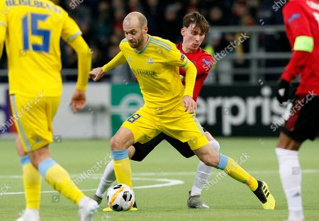 Astana's Ivan Mayewski, centre left, and Manchester United's James Garner challenge for the ball during the Europa League Group L soccer match between Astana and Manchester United in Astana, Kazakhstan