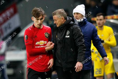 Manchester United's manager Ole Gunnar Solskjaer speaks with Manchester United's James Garner during the Europa League Group L soccer match between Astana and Manchester United in Astana, Kazakhstan