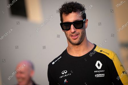 Renault Sport F1 Team's Australian driver Daniel Ricciardo walks through the paddock