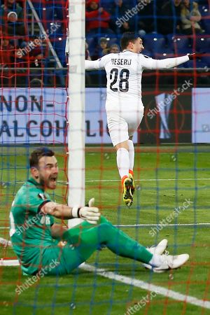 Claudiu Keseru, Igor Akinfeev. Ludogorets??? Claudiu Keseru, right, celebrates after scoring his side's first goal past CSKA???s goalkeeper Igor Akinfeev during the Europa League group H soccer match between CSKA Moscow and PFC Ludogorets Razgrad at CSKA Arena in Moscow, Russia