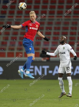Hordur Magnusson (L) of CSKA Moscow in action against Jody Lukoki (R) of Ludogorets during the UEFA Europa League group H soccer match between CSKA Moscow and Ludogorets in Moscow, Russia, 28 November 2019.