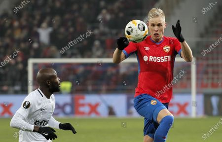 Hordur Magnusson (R) of CSKA Moscow in action against Jody Lukoki (L) of Ludogorets during the UEFA Europa League group H soccer match between CSKA Moscow and Ludogorets in Moscow, Russia, 28 November 2019.