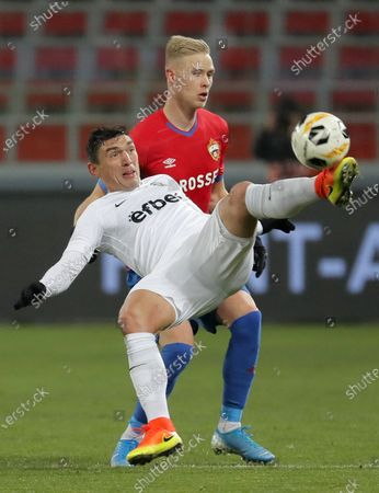 Hordur Magnusson (back) of CSKA Moscow in action against Claudiu Keseru (front) of Ludogorets during the UEFA Europa League group H soccer match between CSKA Moscow and Ludogorets in Moscow, Russia, 28 November 2019.