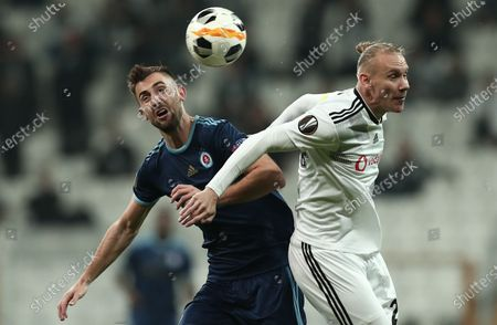 Stock Photo of Besiktas's Domagoj Vida (R) in action against Slovan Bratislava's Andraz Sporar (L) during the UEFA Europa League group K soccer match between Besiktas and SK Slovan Bratislava, in Istanbul, Turkey 28 November 2019.