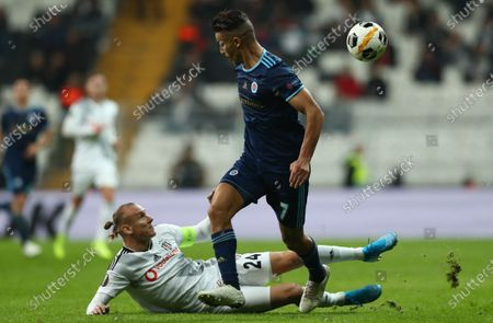 Besiktas's Domagoj Vida (L) in action against Slovan Bratislava's Mohammed Rharsalla (R) dduring the UEFA Europa League group K soccer match between Besiktas and SK Slovan Bratislava, in Istanbul, Turkey 28 November 2019.