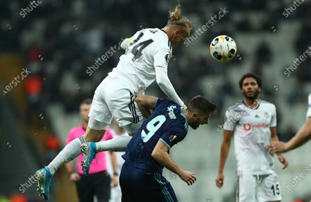 Besiktas's Domagoj Vida (L) in action against Slovan Bratislava's Andraz Sporar (R) during the UEFA Europa League group K soccer match between Besiktas and SK Slovan Bratislava, in Istanbul, Turkey 28 November 2019.