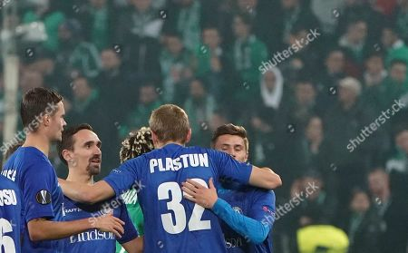 Stock Picture of Gent players celebrate at the end of the Europa League group I soccer match between Saint Etienne and Gent at Geoffroy Guichard stadium in Saint Etienne, central France