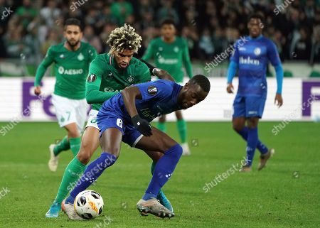 Gent's Elisha Owusu, front, duels for the ball with Saint-Etienne's Mahdi Camara during the Europa League group I soccer match between Saint Etienne and Gent at Geoffroy Guichard stadium in Saint Etienne, central France