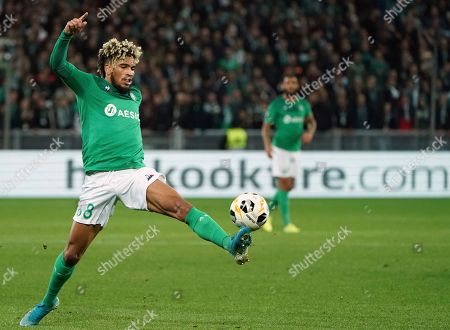 Saint-Etienne's Mahdi Camara kicks the ball during the Europa League group I soccer match between Saint Etienne and Gent at Geoffroy Guichard stadium in Saint Etienne, central France