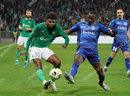 Gent's Elisha Owusu, right, tries to block a shot from Saint-Etienne's Wesley Fofana during the Europa League group I soccer match between Saint Etienne and Gent at Geoffroy Guichard stadium in Saint Etienne, central France