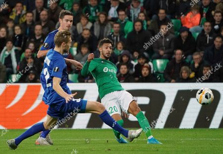 Gent's Igor Plastun, front left, tries to block a shot from Saint-Etienne's Denis Bouanga, right, during the Europa League group I soccer match between Saint Etienne and Gent at Geoffroy Guichard stadium in Saint Etienne, central France