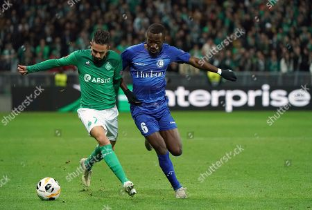 Saint-Etienne's Ryad Boudebouz, left, duels for the ball with Gent's Elisha Owusu during the Europa League group I soccer match between Saint Etienne and Gent at Geoffroy Guichard stadium in Saint Etienne, central France