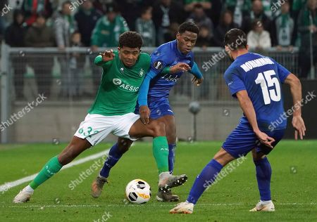 Saint-Etienne's Wesley Fofana, left, duels for the ball with Gent's Michael Ngadeu-Ngadjui, center, during the Europa League group I soccer match between Saint Etienne and Gent at Geoffroy Guichard stadium in Saint Etienne, central France