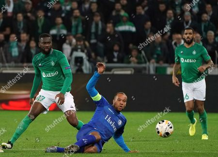 Saint-Etienne's Jean-Eudes Aholou, left, duels for the ball with Gent's Vadis Odjidja-Ofoe during the Europa League group I soccer match between Saint Etienne and Gent at Geoffroy Guichard stadium in Saint Etienne, central France