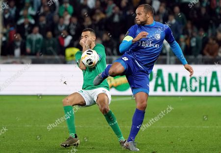 Gent's Vadis Odjidja-Ofoe, right, duels for the ball with Saint-Etienne's Timothee Kolodziejczak during the Europa League group I soccer match between Saint Etienne and Gent at Geoffroy Guichard stadium in Saint Etienne, central France