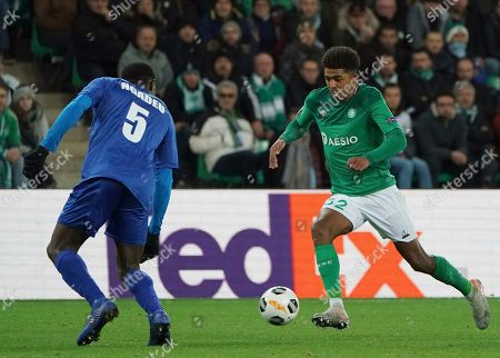 Saint-Etienne's Wesley Fofana, right, duels for the ball with Gent's Michael Ngadeu-Ngadjui during the Europa League group I soccer match between Saint Etienne and Gent at Geoffroy Guichard stadium in Saint Etienne, central France