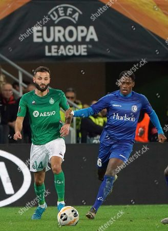 Saint-Etienne's Franck Honorat, left, and Gent's Jonathan David run for the ball during the Europa League group I soccer match between Saint Etienne and Gent at Geoffroy Guichard stadium in Saint Etienne, central France