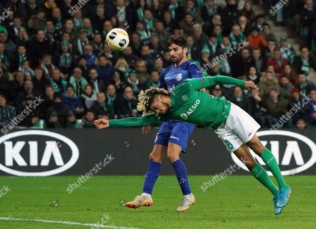 Saint-Etienne's Mahdi Camara, front, duels for the ball with Gent's Milad Mohammadi during the Europa League group I soccer match between Saint Etienne and Gent at Geoffroy Guichard stadium in Saint Etienne, central France